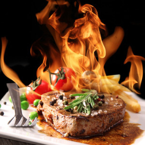 Grilled meat with fire flames